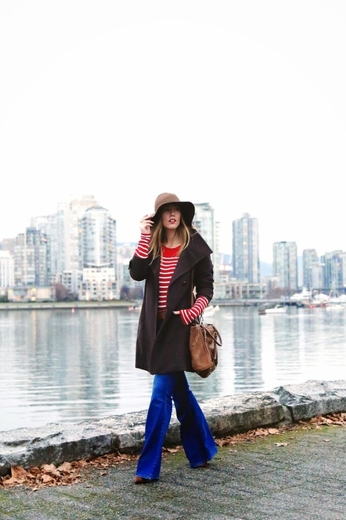 to vogue or bust, vancouver style blog, vancouver fashion blog, vancouver travel blog, vancouver health blog, vancouver lifestyle blog, canadian fashion blog, canadian health blog, canadian style blog, canadian travel blog, canadian lifestyle blog, alexandra grant, old navy flare jeans, aritzia wilfred coat, forever 21 striped shirt, joe fresh pony hair shoes, monoprix floppy hat, roots grace bag, how to pull off seventies style, how to style flare jeans, how to style oversized proportions, how to wear oversized layers, seventies style, 70s style tips, how to wear seventies style, how to make flare jeans work, retro 70s style, how to style a floppy hat, how to wear a floppy hat, best fashion blogs, best style blogs, best health blogs, best fitness blogs, best lifestyle blogs, best travel blogs, top fashion blogs, top style blogs, top health blogs, top fitness blogs, top lifestyle blogs, top travel blogs