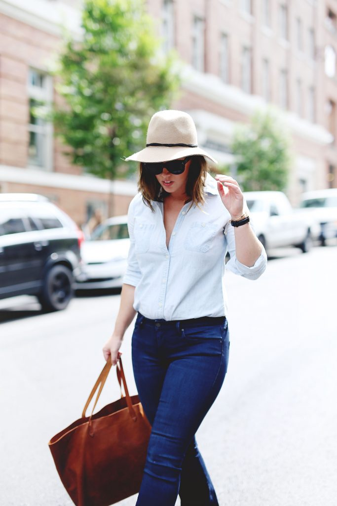 Chambray top, flared denim, wool hat, leather tote.