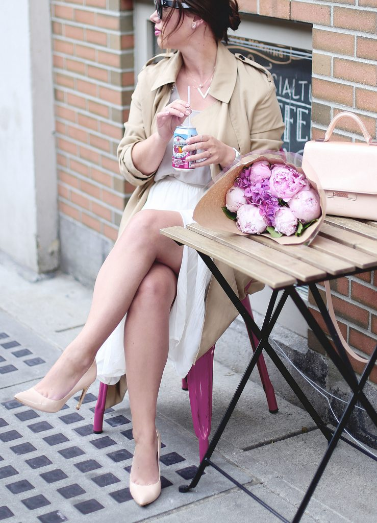 Trench coat, white silk skirt, nude pumps