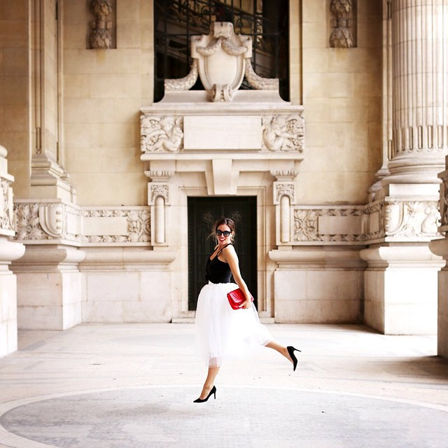 To Vogue or Bust wears a tulle skirt in Grand Palais, Paris