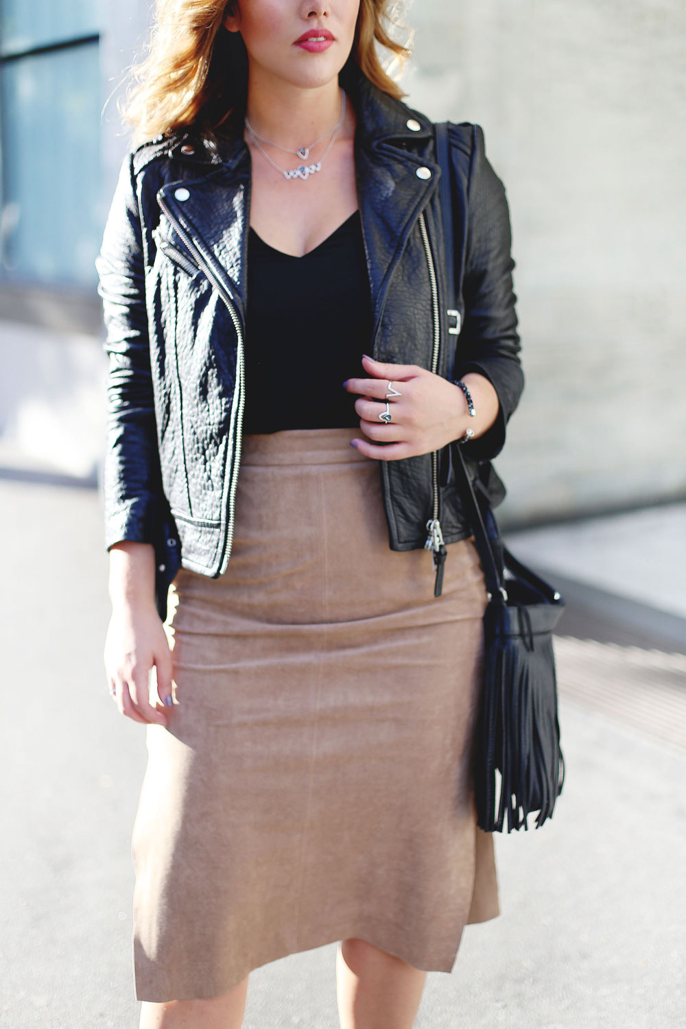 Edgy fall style tips: how to layer jewelry in Swarovski jewelry, Aritzia suede pencil skirt, Aritzia black camisole, Mackage leather jacket, Express black heels and Aritzia Wilfred fringe leather bag
