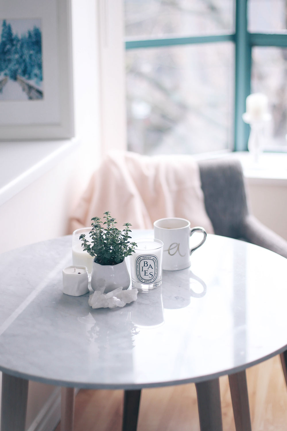 How to decorate small apartments for the holidays with Article Mara marble table, Chanel grey chairs
