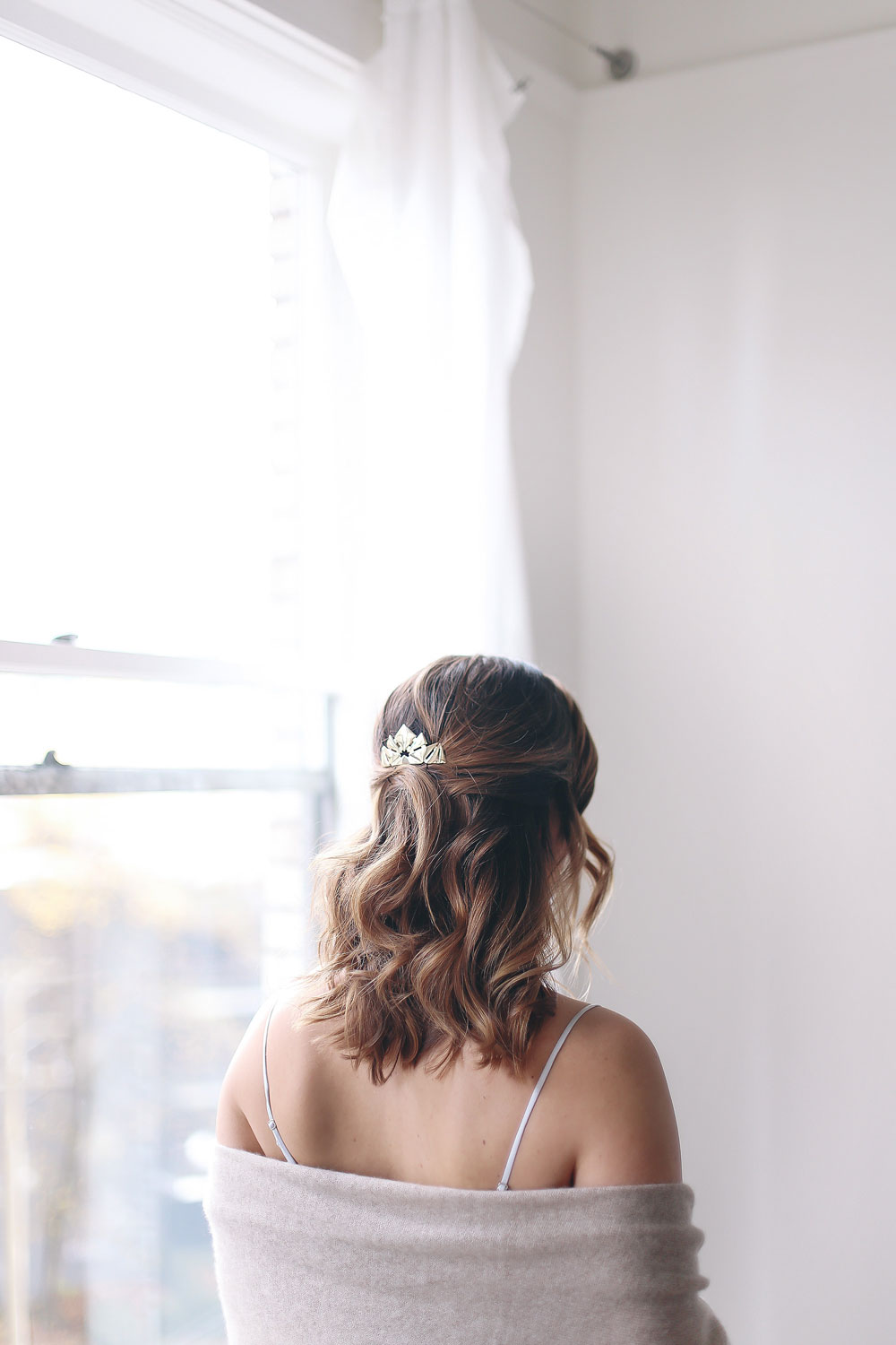 Best holiday hairstyle: half up with metallic hair accessory by Chris Weber Hair on To Vogue or Bust