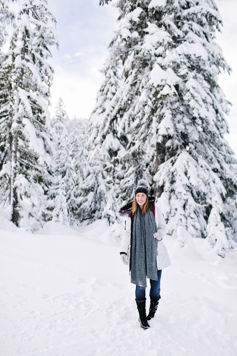 What to wear in the snow in Vancouver, with Noize parka, Express pom pom beanie, Sorel boots, White and Warren cashmere travel wrap and Aritzia mittens styled by To Vogue or Bust